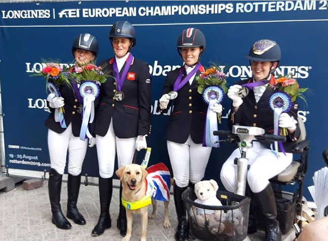 Mari Akhurst and Team GBR show off their medals
